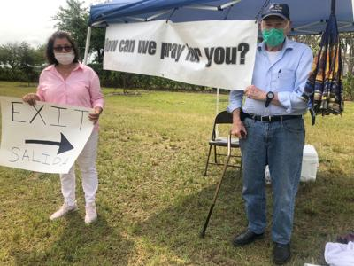 """Dr. Alex Jones and his wife, Marta, spoke with a number of people who came to,  """"The Prayer Corner""""."""