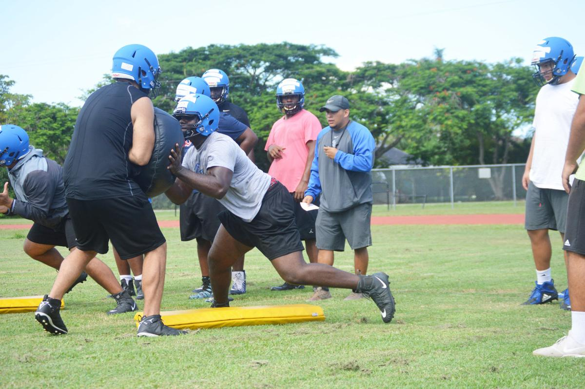 Jonathan Denis hits the sled as South Dade begins practices.