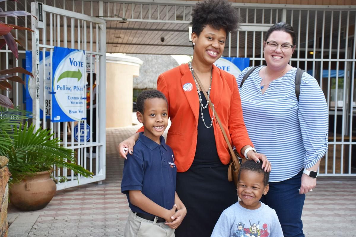 Voting at the Villages are Brenton, Lis and Quincy Cooper, and Megan Ivill.