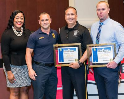 Councilwoman Patricia Fairclough  recognized Lt. Bryce Barker and Detective Raul Cabrera, pictured with  Fire Lieutenant Rene Noa.