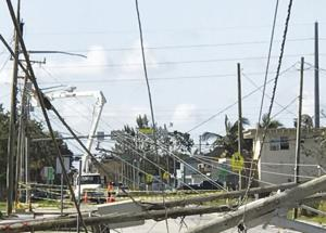 Repairing downed power lines is a major priority of recovery crews.
