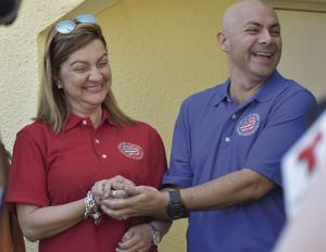 Retired Staff Sergeant Carlos HenaoGallego and his wife Monica Caro receive the keys to their new, mortgage-free home, courtesy of Wells Fargo.