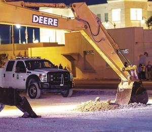 Groundbreaking is sometimes better done with heavy  equipment than a traditional shovel