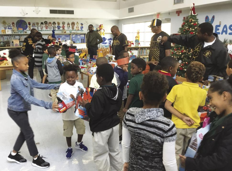 Brothers bring the joy of Christmas to area children