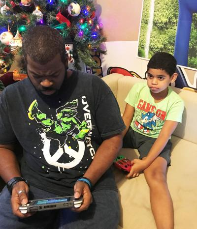Kevin Lewis gaming with his son Nathaniel, 7.