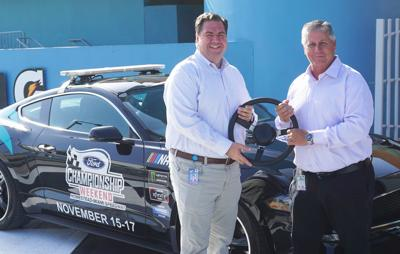 "Former President Matthew Becherer ""hands the wheel"" to Al Garcia as the new president of Homestead-Miami Speedway."