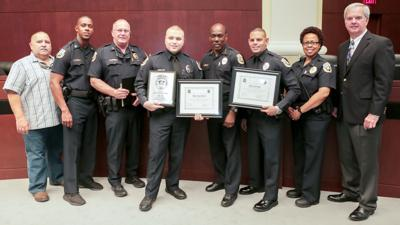 Mayor Jeff Porter (far right) and Chief Al Rolle (center) along with police department staff, honor Homestead Police officers Joseph Rivera and Juan Roa.