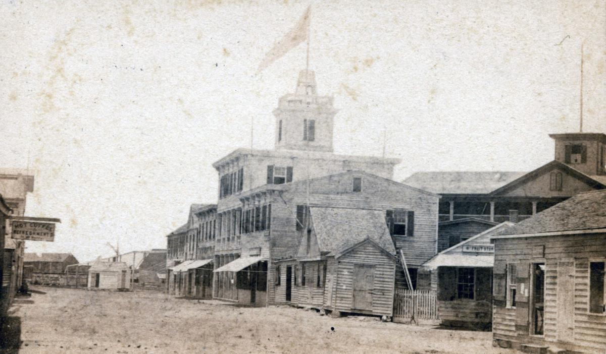 Front Street near Duval Street in Key West, August 1865 from the Louisa White Collection.