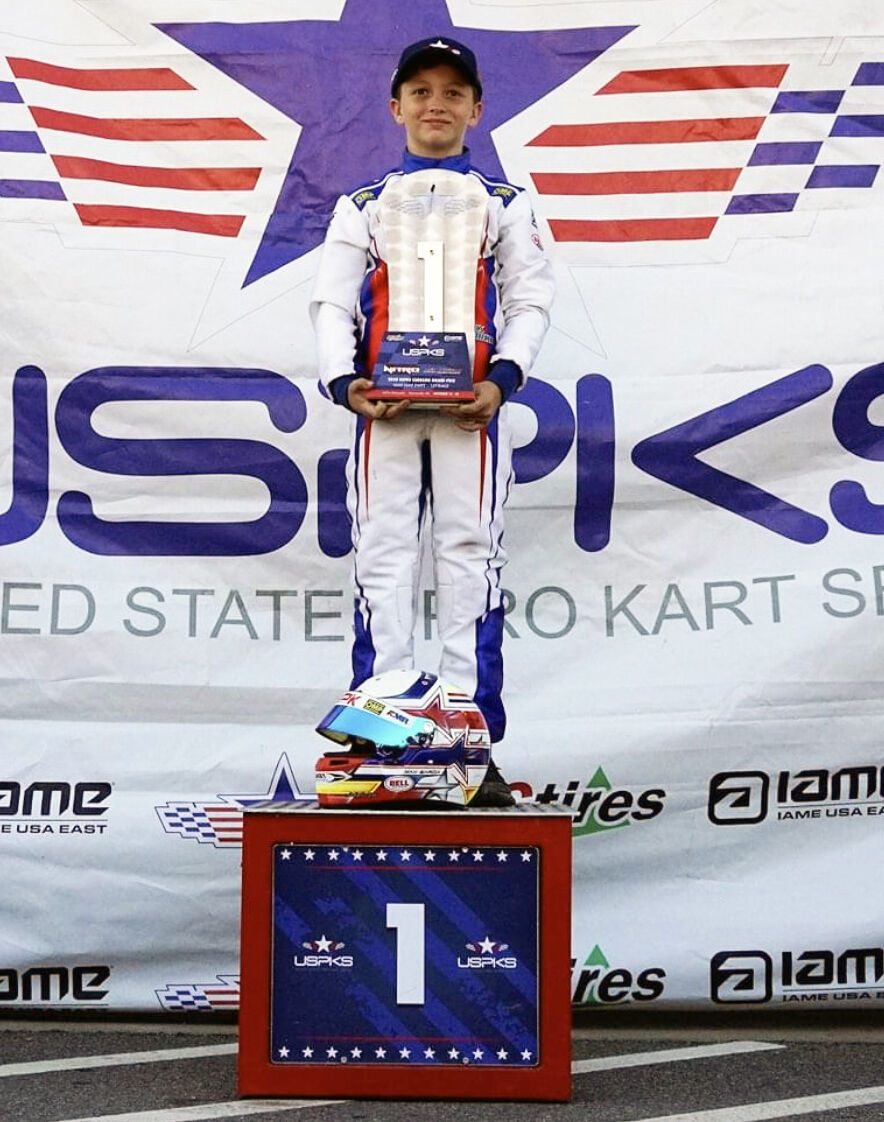 Garcia takes the first place series championship trophy in Mini Swift.