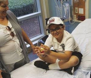 A patient at Homestead Hospital receives a Ford EcoBoost 200 hat.