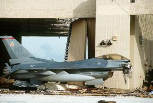 F-16C damaged on the Homestead AFB tarmac in the aftermath of Hurricane Andrew.