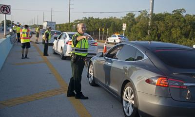 Monroe County Sheriff's Office Col. Lou Caputo directs a driver wanting to continue down the Florida Keys Overseas Highway