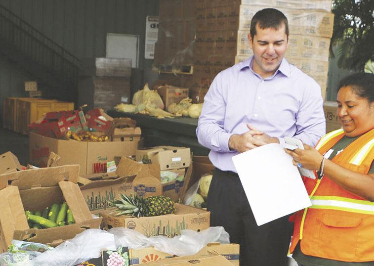 Stephen Shelley, incoming Mayor of Homestead also serves as the President of Farm Share, a state-wide food  distribution service working to elimate hunger.  Shelley is shown here at the Homestead distribution center.