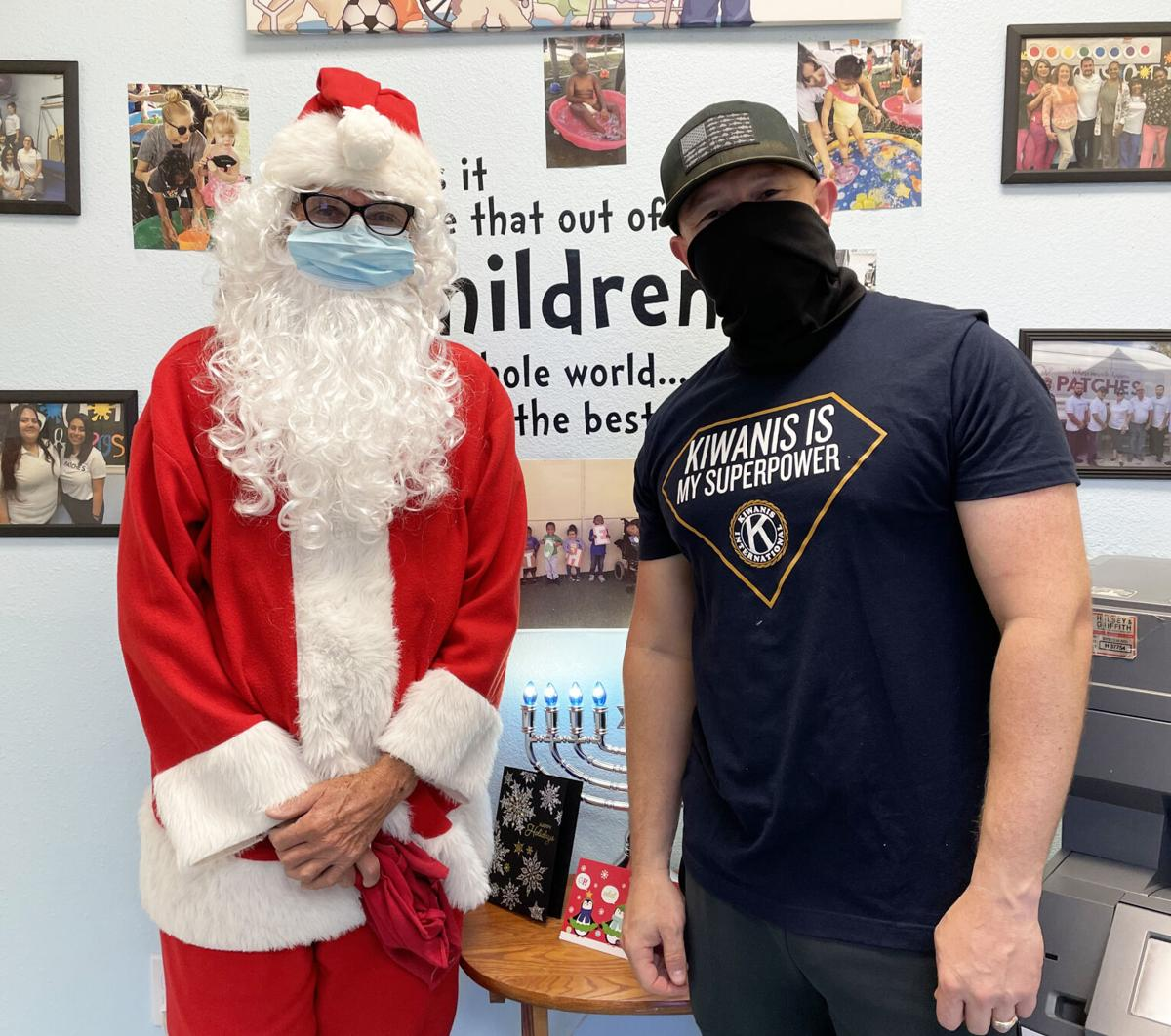 Rotary Club Santa, Phil Marraccini and 1st Lt. Arnold A. Perez of the Kiwanis Club of Homestead-South Dade, joined together to bring toys to children at PATCHES PPEC.