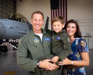 Col. David Piffarerio, with his son Bryce and his wife Jennifer.