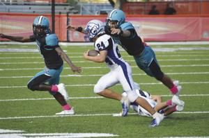 Coral Reef's Chris Perez leaps for the tackle.