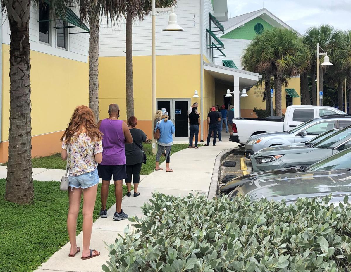 Twenty eight people were in line down the sidewalk at noon on Monday to vote at the Murray Nelson Government Center in Key Largo.