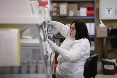 Aubrey Holland performs tests at the Bureau of Public Health Laboratories on Monday, March 2, 2020, in Miami, where the COVID-19 virus is being tested.