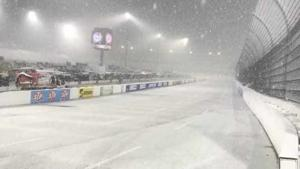 Martinsville Speedway was socked in by a snowstorm, delaying racing by a day.