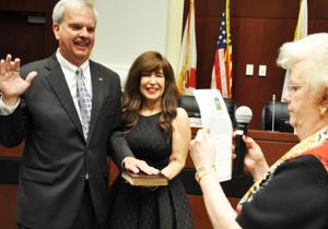 Jeff Porter, with his wife Cindy, being sworn for his 3rd term as mayor of  the City of Homestead. Porter received the oath from his mother, Marlene.