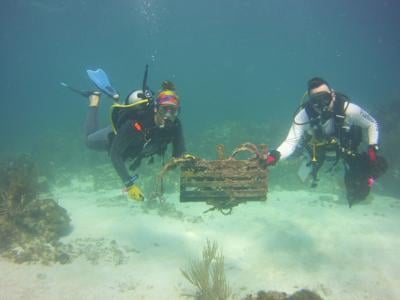 Broken traps are brought up by Island Ventures divers  during Dive Against Debris clean-ups.