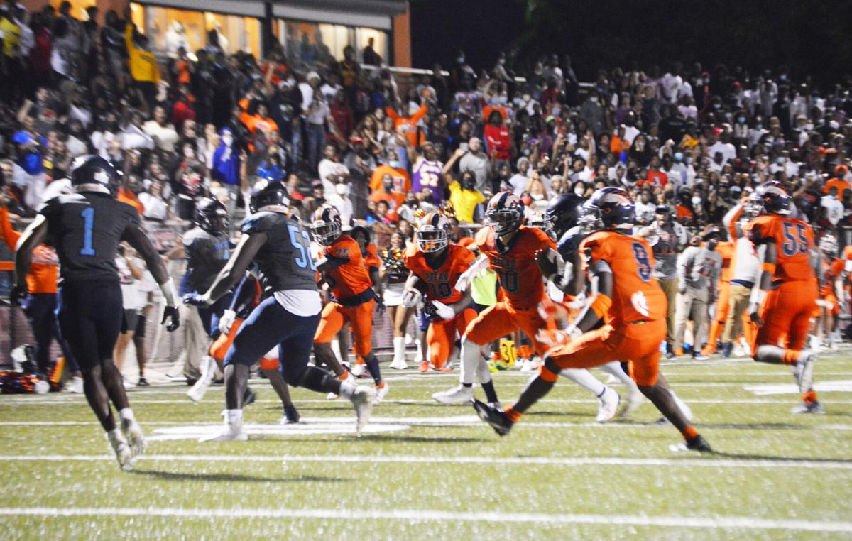 Senior Noah Lyons runs the ball as the crowd, with over 2100 in the stands, cheers him on.