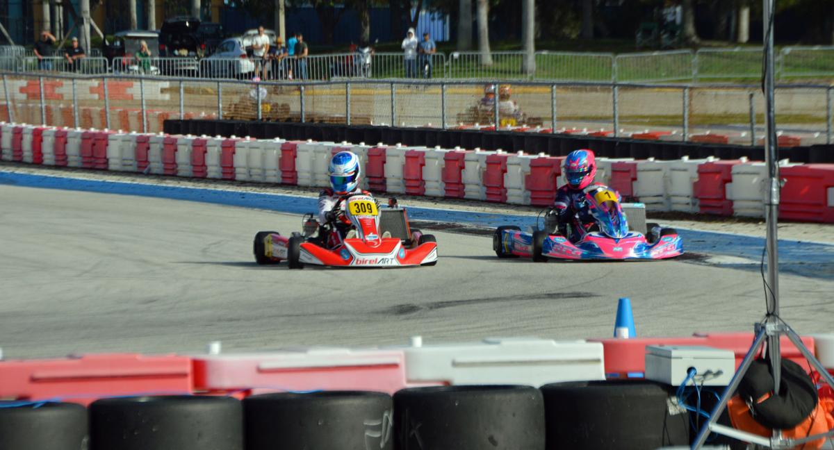 Patrick Woods-Toth (309) races neck-and-neck with Ryan Norberg (1).