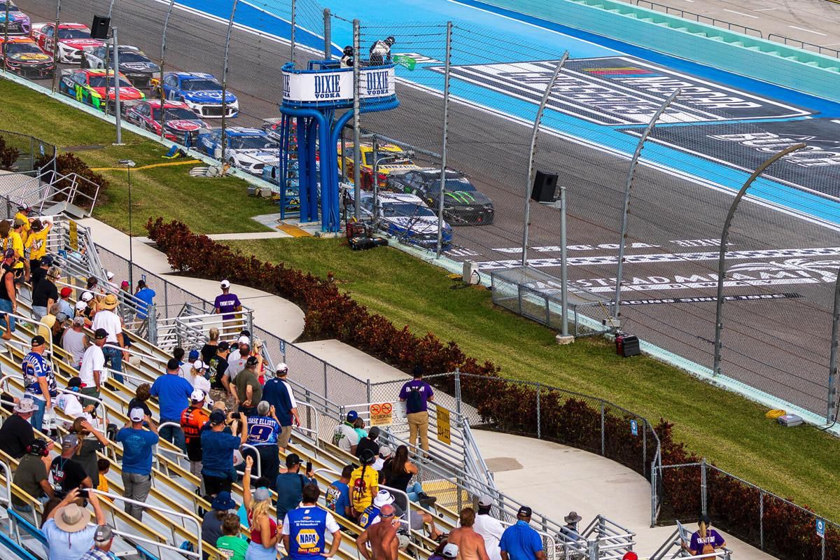 Fans cheer as the green flag waves.