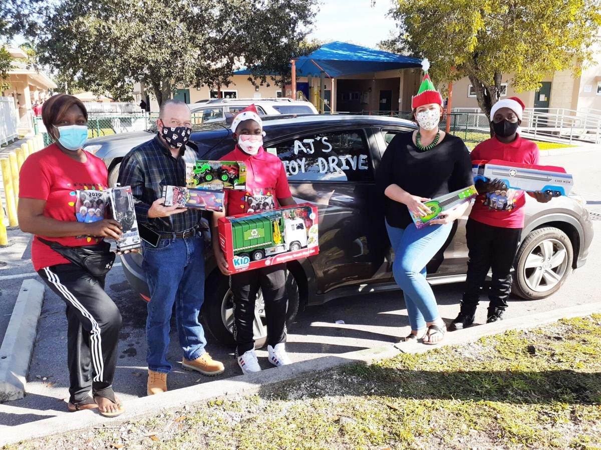 Wearing masks doesn't stop the smiles brought by AJ's Toy Drives.