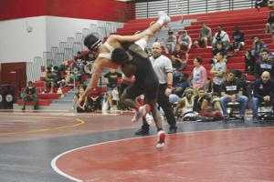 Southridge's Johnny Lovett getting Jason Duarte in the air in the 152-pound final