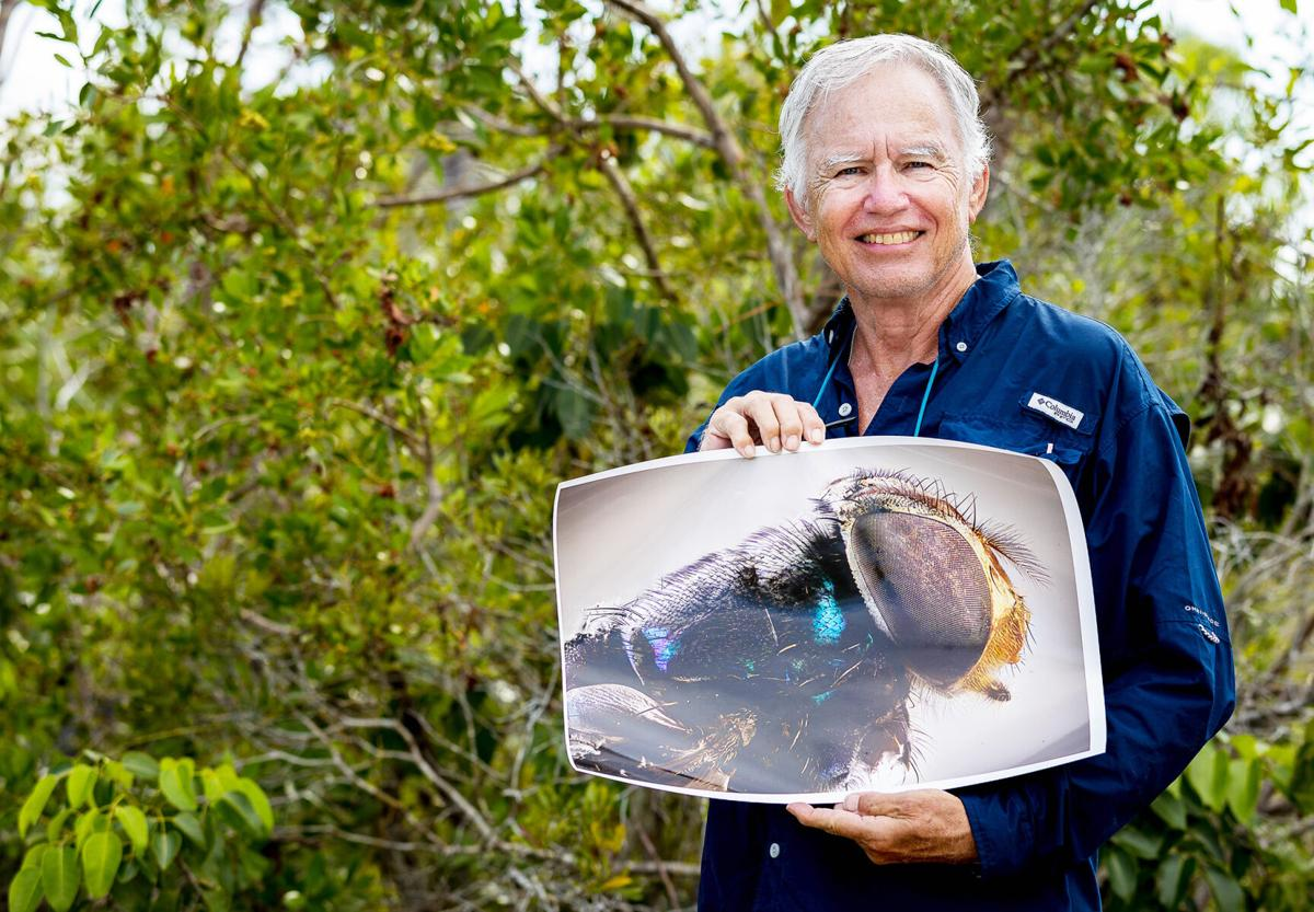 """The South Florida National Parks Camera Club holds socially distant field trips to learn about all types of  photography from landscapes to portraits. Member Bob Richardson served as a model for a """"Flash Field Trip""""."""