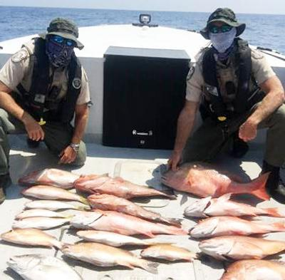 Officers Martin Messier and Officer Glen Way of the Florida Fish and Wildlife Conservation Commission (FWC)