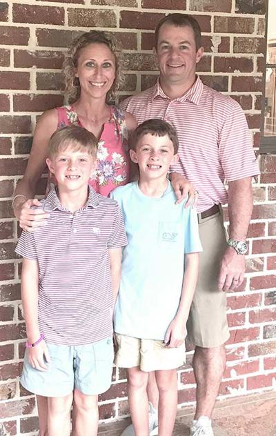 Haley Willette poses for a family photo