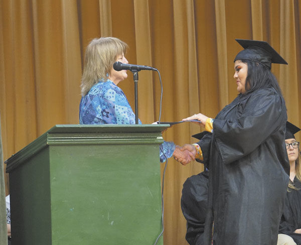 YES Program grads walk at Old Coppinville
