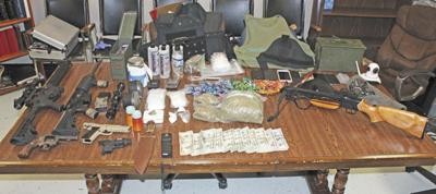DPD recovers weapons, drugs in search