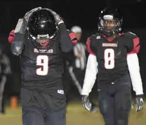 <p>Daleville's Nefabian Hudson (9) and Torrey Hobdy (8) look on in disbelief after Leroy's game-winning touchdown Friday night.</p>