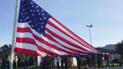 Community comes together to raise new flag