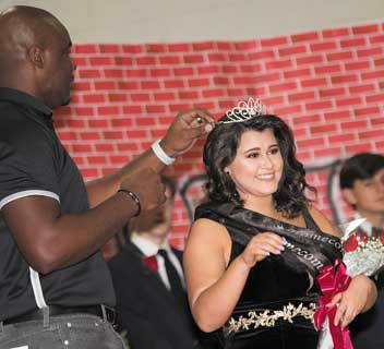 Paige Bright is crowned Homecoming Queen by NBHS Principal Alonzo Barkley