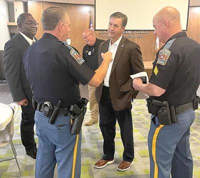 U.S. Rep. Barry Moore talks with local law enforcement