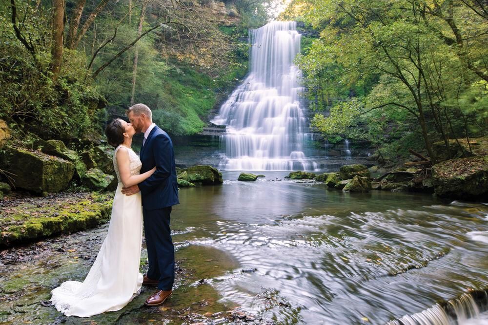 Evins Mill bride & groom at falls