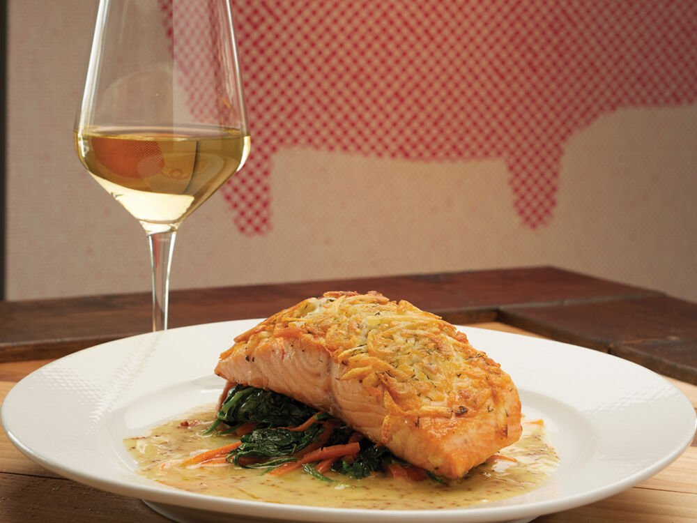 The potato crusted salmon is a favorite at Pork Belly Farmhouse