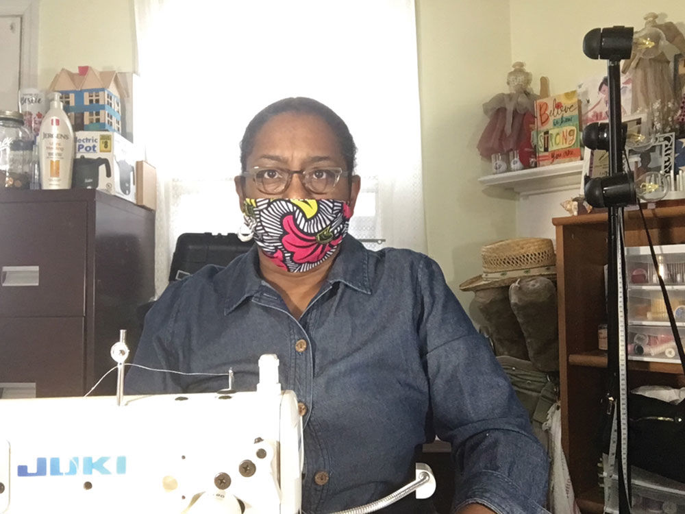 Doris McMillan, local seamstress, pictured in her work space