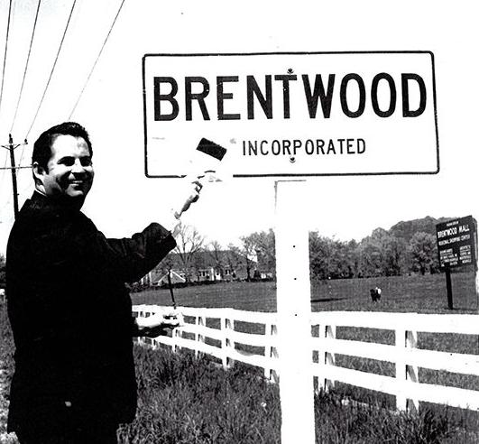 "Brentwood Chamber President Chick Boggan paints out the ""un"" to transform Brentwood from an unincorporated area to a city in 1969."