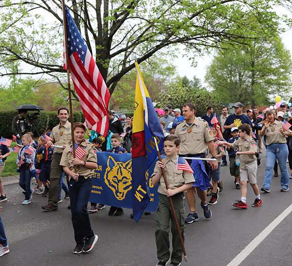 Boy Scout troops participate in the parade.