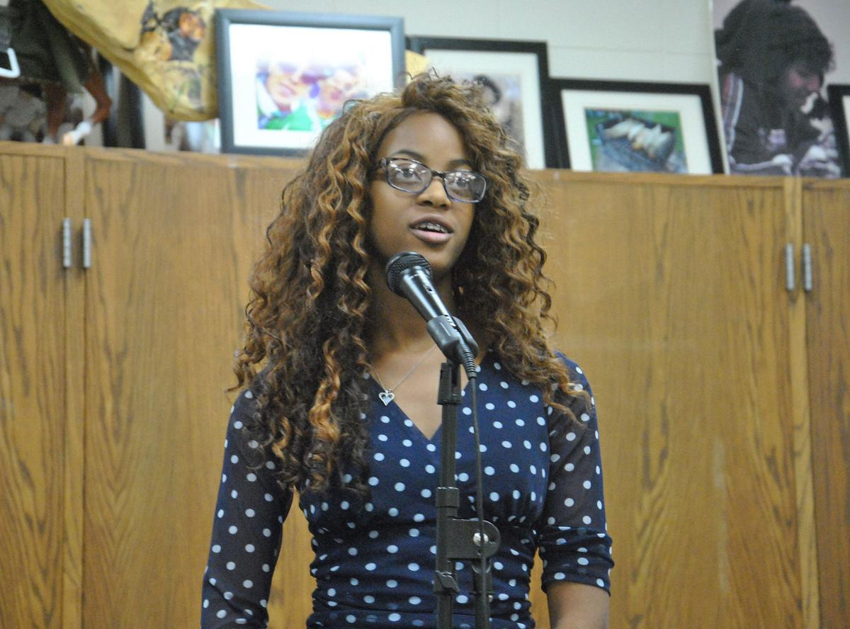NHS student rehearses for TORCH Poetry Slam
