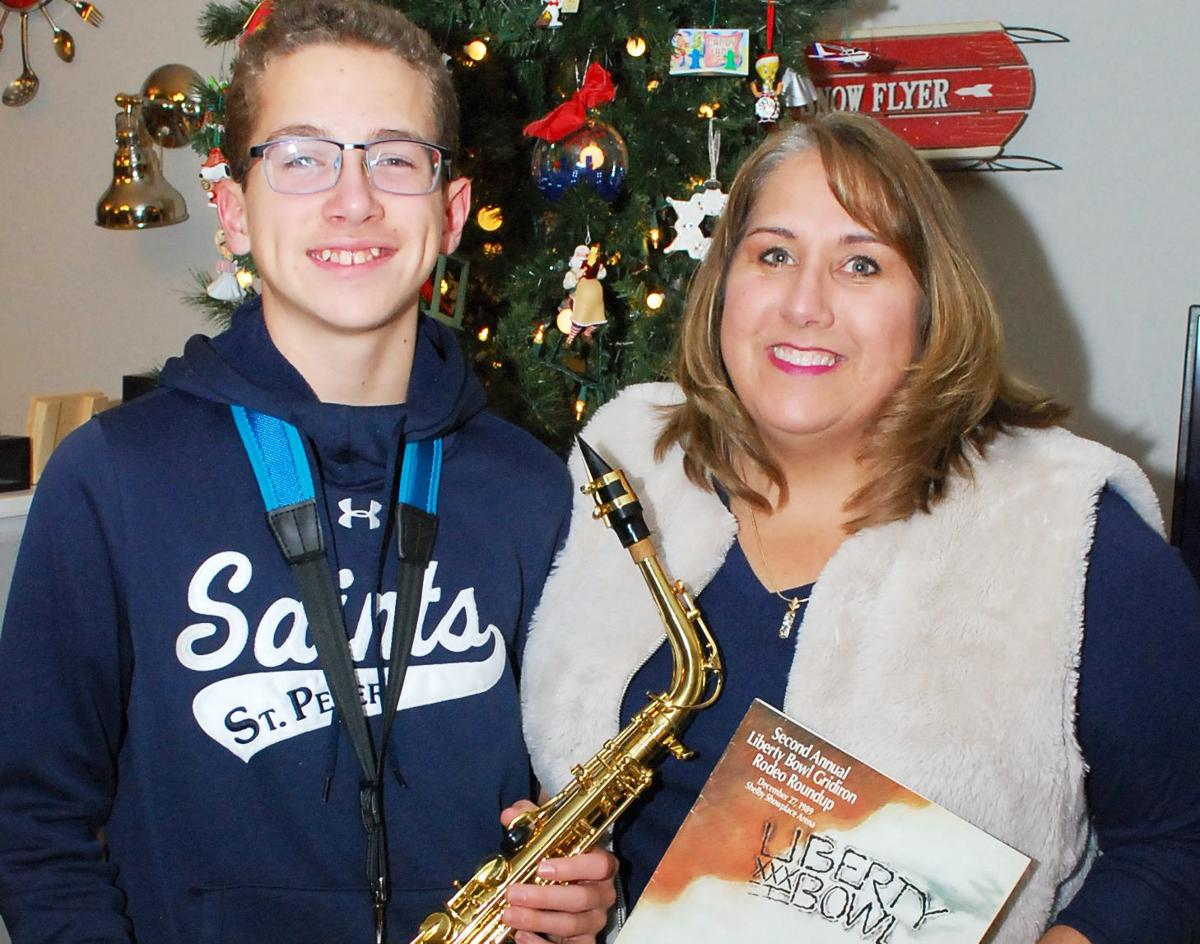 30 years after mom performed in Liberty Bowl, SPHS Marching Band son will do the same