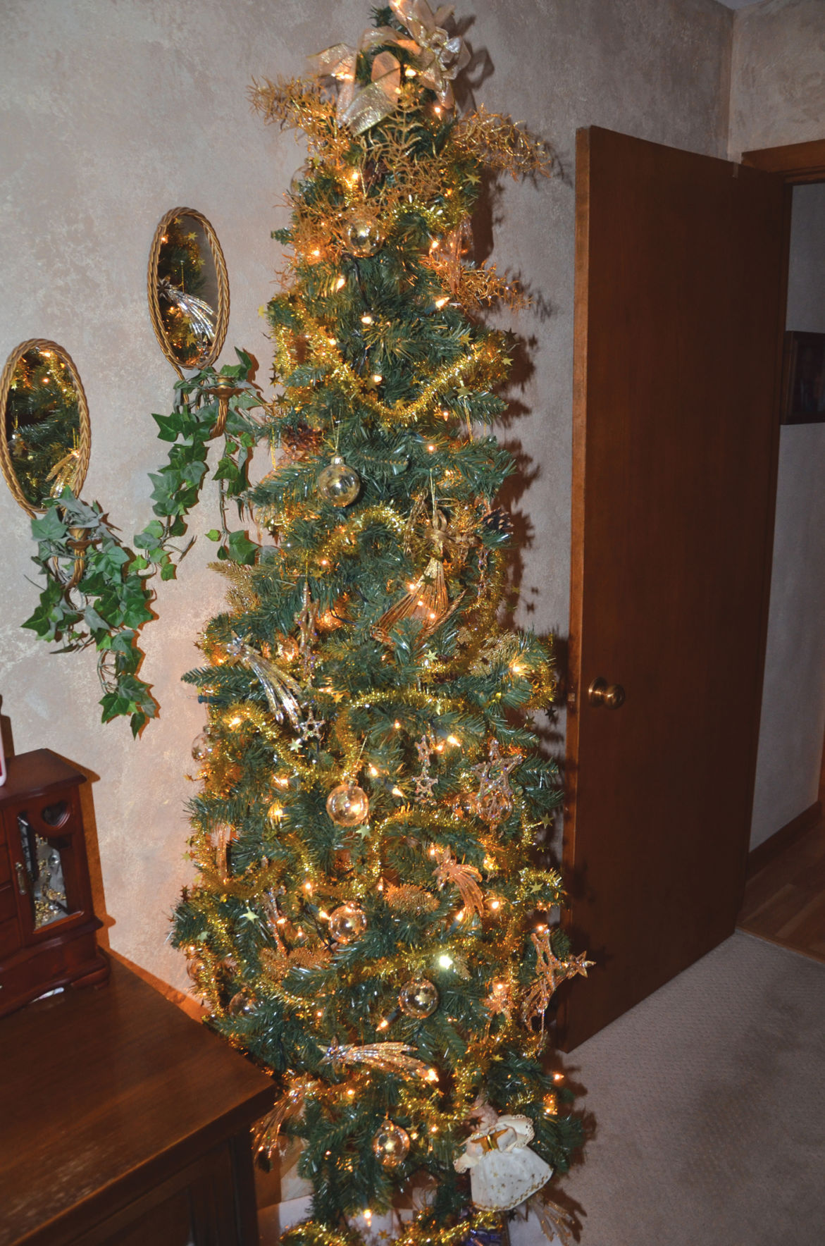 Local resident goes all out for Christmas with trees of multiple