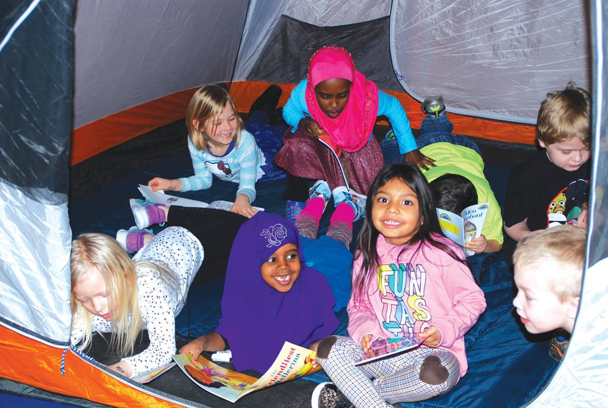 Wilson gym becomes campsite, complete with s'mores, tents, and reading
