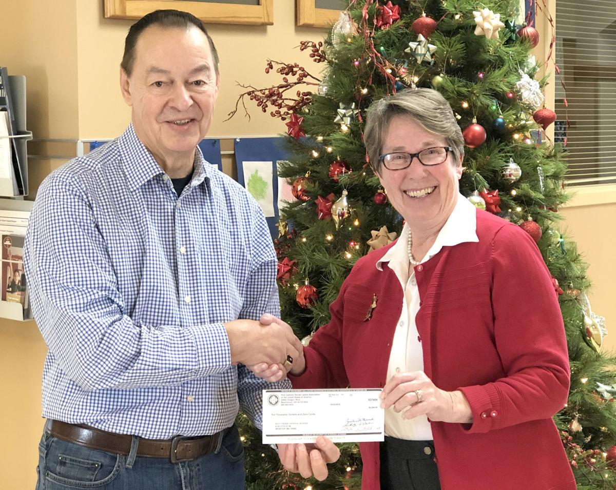 FCSLA presents check to Webster School