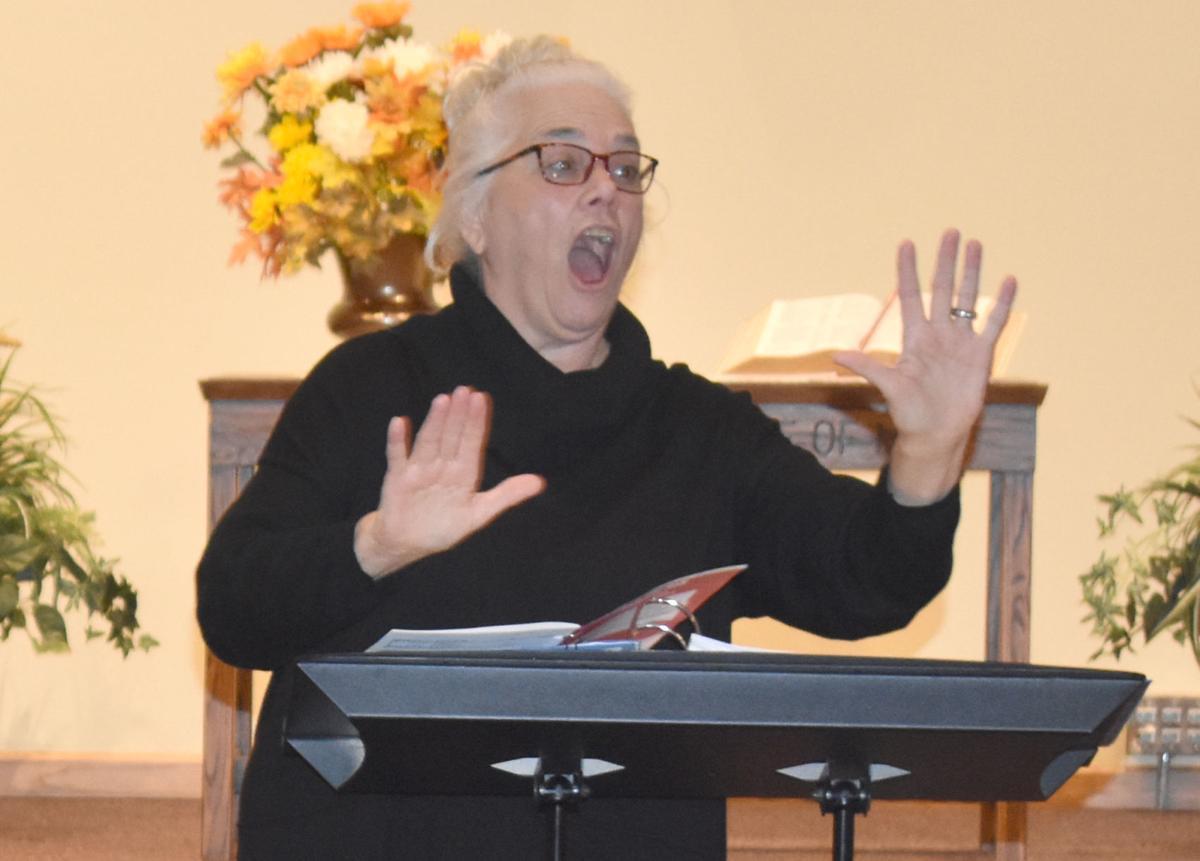 Choir director's impact spans distances, generations